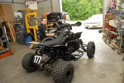 Jeff Tweet and his custom ATV inside his shop