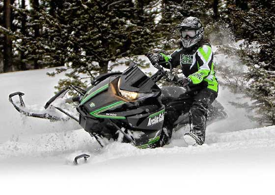 Demo ride a 2013 Arctic Cat M snowmobile in West Yellowstone