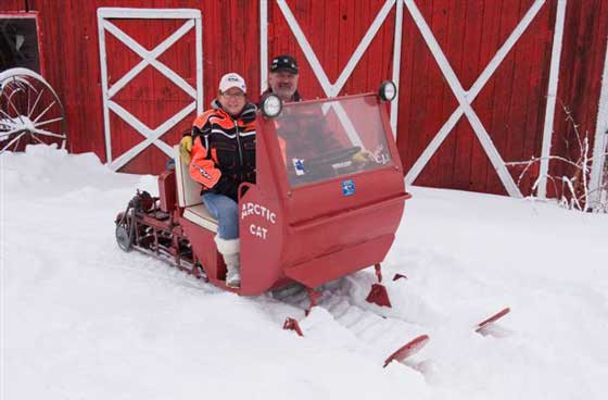 Barb & Dave Guenther loving life on their antique Arctic Cat