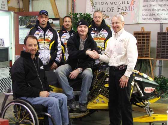 Blair Morgan donates a sled to Snowmobile Hall of Fame