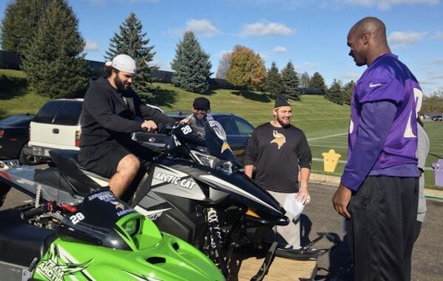 Minnesota Vikings Adrian Peterson give Arctic Cat snowmobiles to his offensive line.
