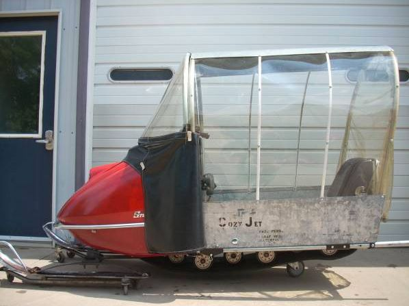 Vintage snowmobile with bubble kit.
