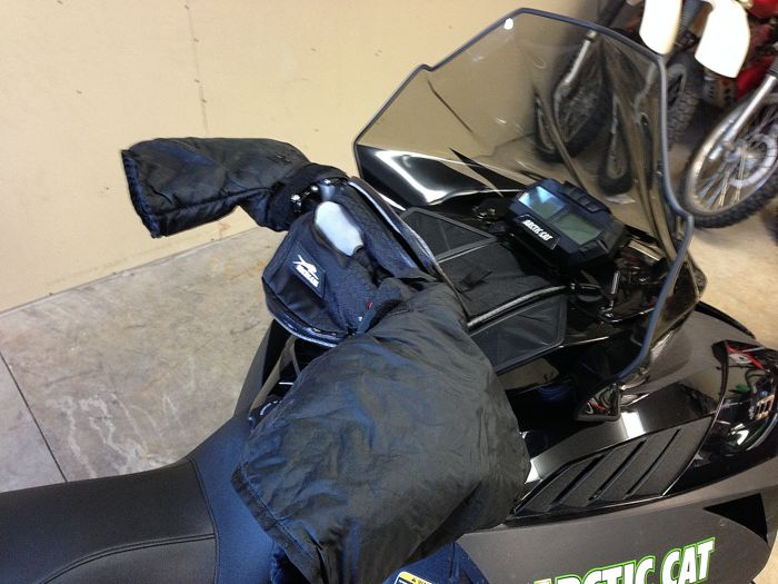 My favorite piece of snowmobile gear: handlebar muffs. Photo ArcticInsider.com