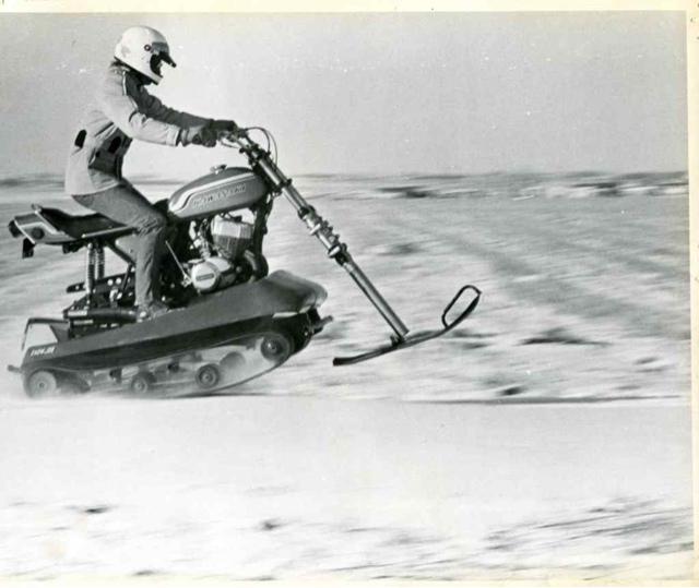 Vintage snow bike, snow vehicle, snowmobile