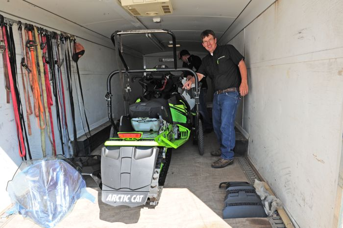 Tom Rowland and his collector Arctic Cat race sleds. Photo ArcticInsider.com