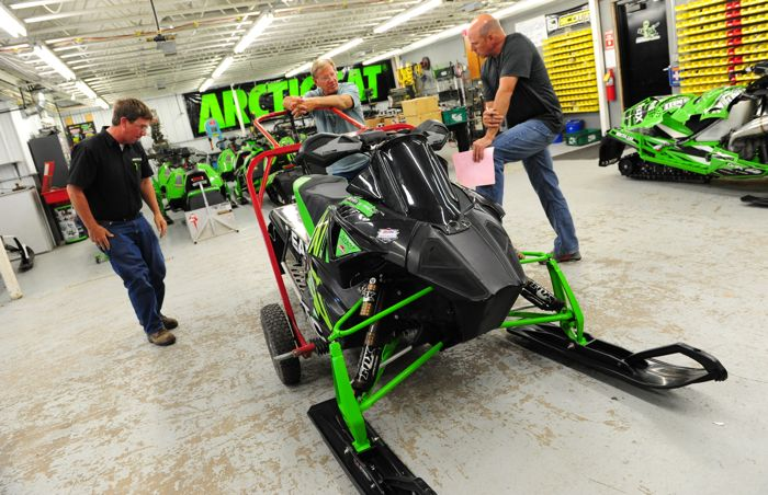 Rowland, Dimmerman and Kloety with Cody Thomsen's snocross race sled. Photo ArcticInsider.com
