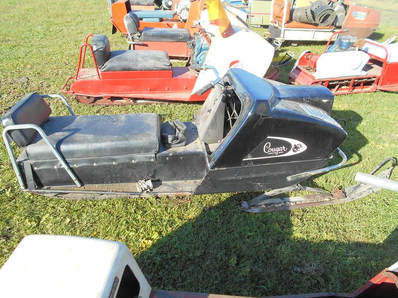 Vintage sled auction with Arctic Cat machines.