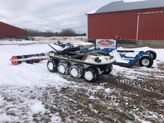 Rum River Sno Riders use an ARGO and roller