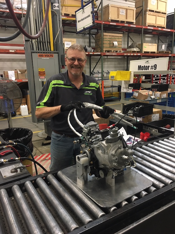 Tim Johnson stops for a quick photo as he installs wiring harness on the new Blast engine.