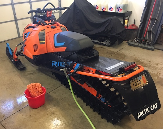 Start by giving your snowmobile a bath.