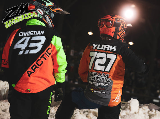 Yurk standing trackside with #43 Pro Logan Christian planning his track attack