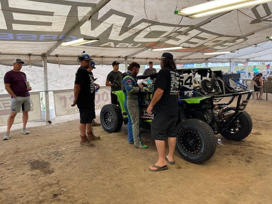 Under the awning of Speedwerx 53' race trailer Jeremy gets ready for Saturdays Final