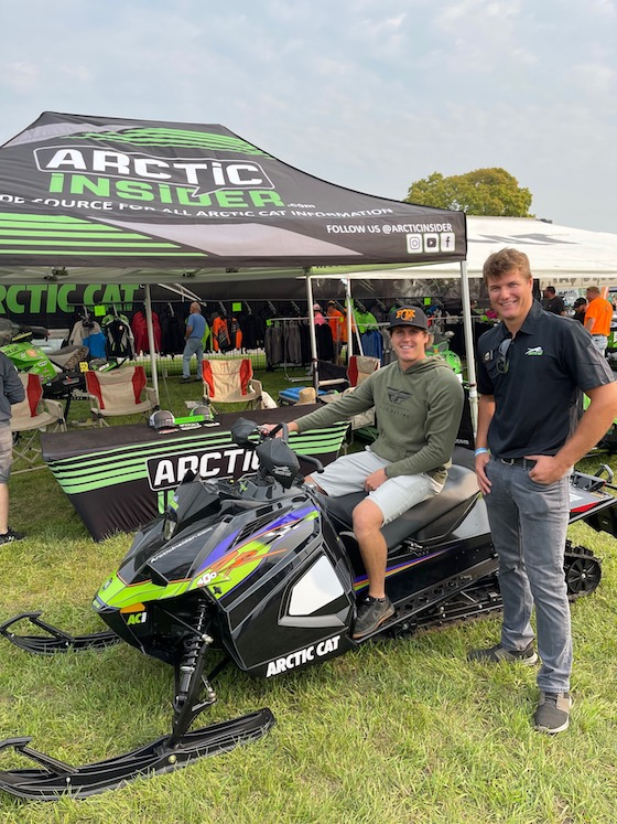Team Arctic Cross Country Pro Zach Herfindahl (seated) and Ben Langaas (Arctic Cat Performance Team Engineer)